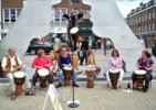 [ Bedford Djembe Group playing at Bedford Busking Festival ]