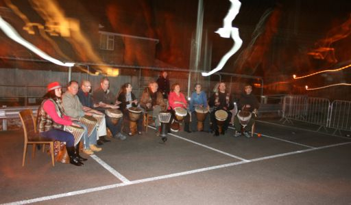 [ Bedford Djembe Group playing at Keech Hospice charity firewalk, photo by Gnewt Photography ]