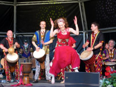 [ Justine dancing with Vitae Drummers at Waddesdon Manor, 2011 ]